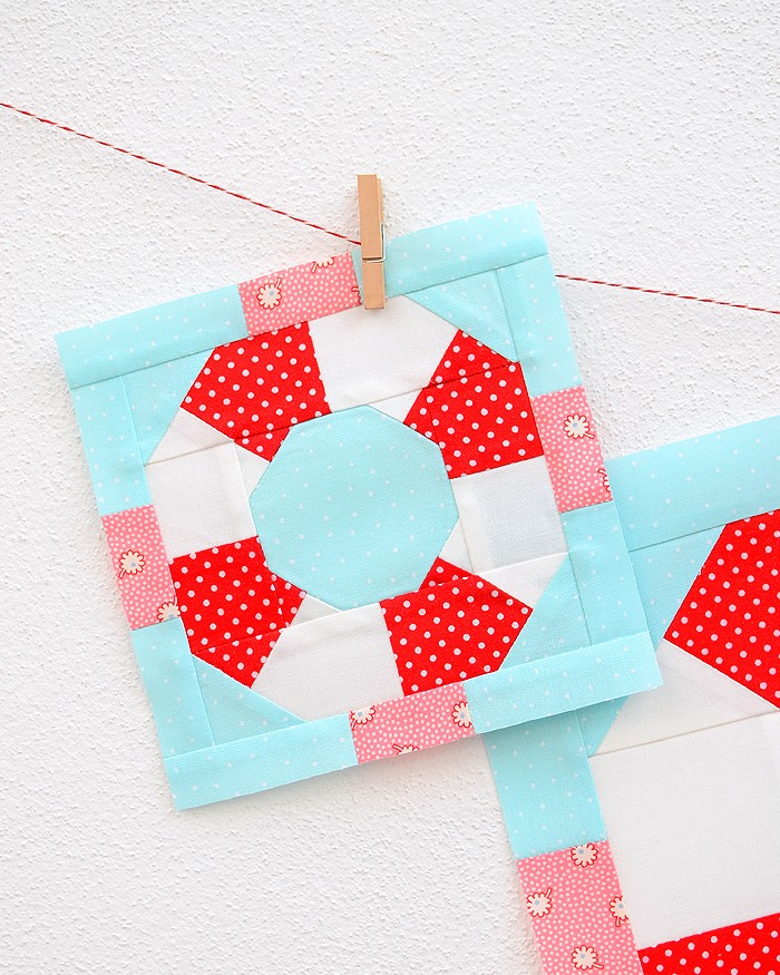 6 Inch Lifesaver quilt block hanging on a wall