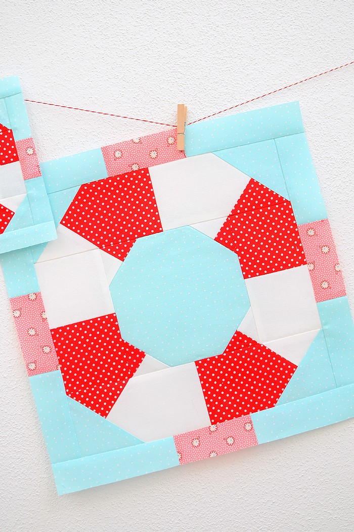 12 Inch Lifesaver quilt block hanging on a wall