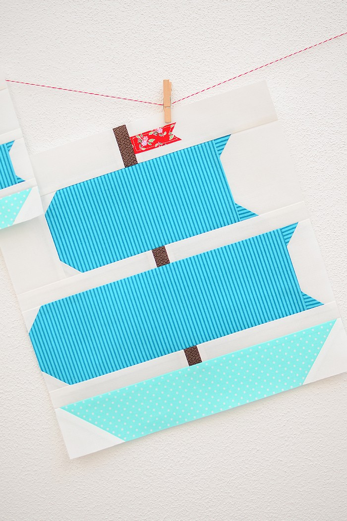 12 Inch Sail boat quilt block hanging on a wall