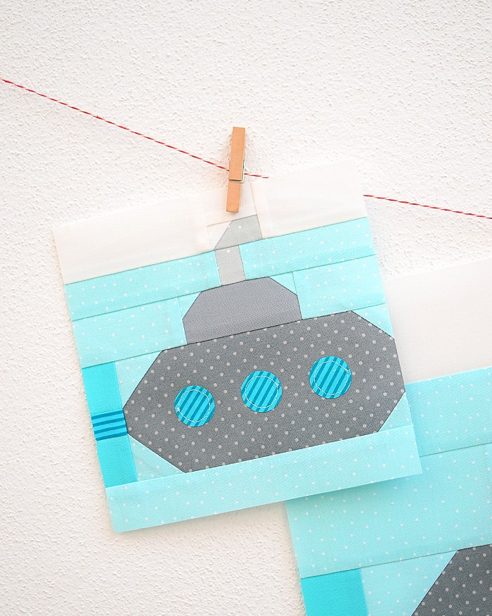 6 Inch Submarine quilt block hanging on a wall