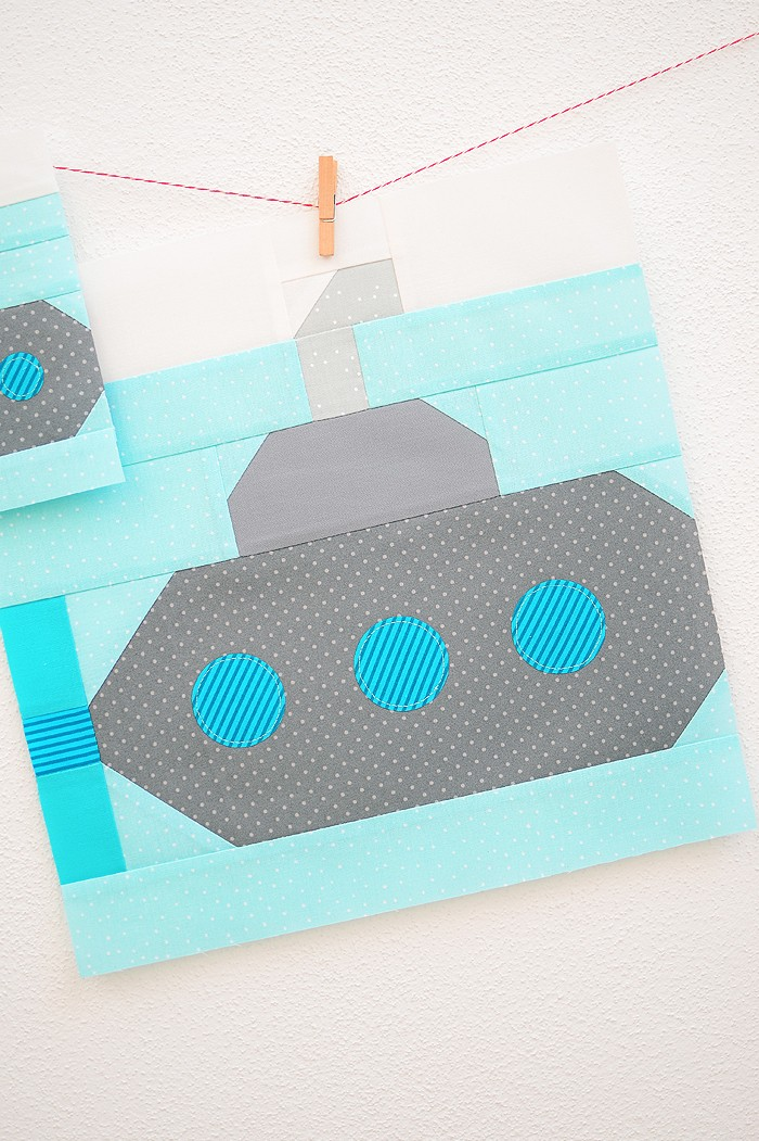 12 Inch Submarine quilt block hanging on a wall