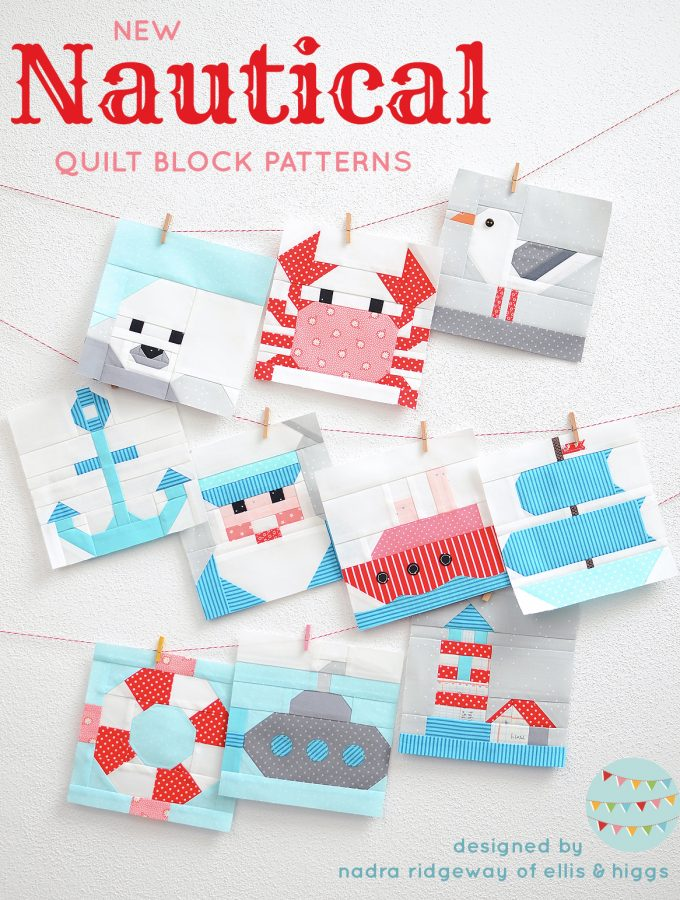 Ten nautical quilt blocks hanging on the wall.
