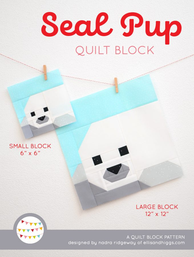 Seal Pup quilt block in two sizes hanging on a wall