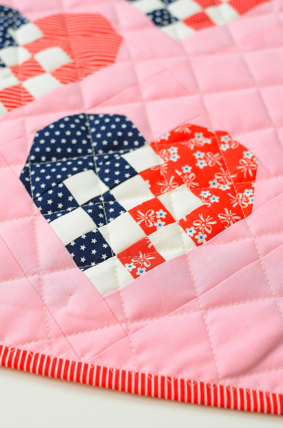 Patriotic quilt pattern with hearts in red, white and blue