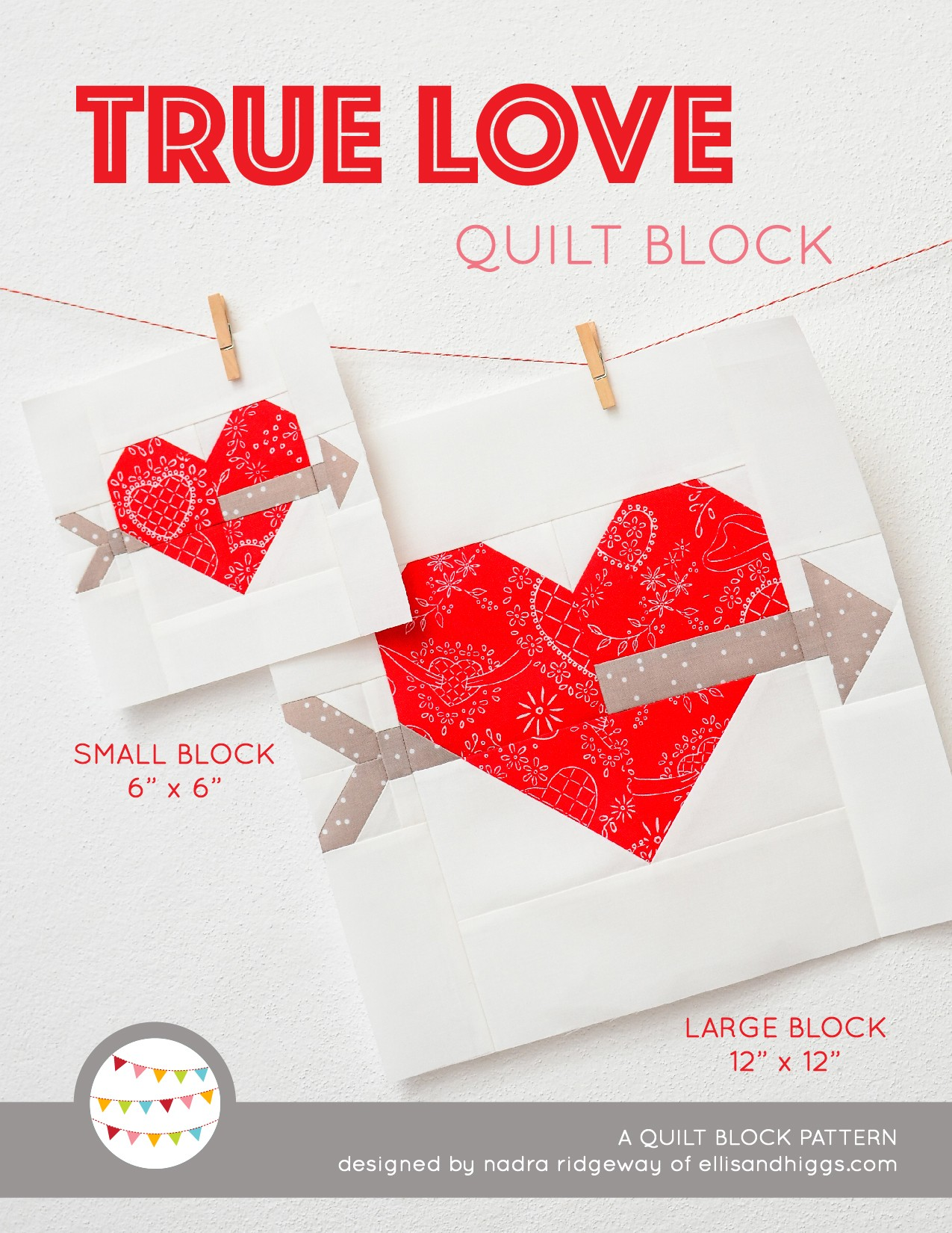 Cupid's Arrow Heart quilt block in two sizes hanging on a wall
