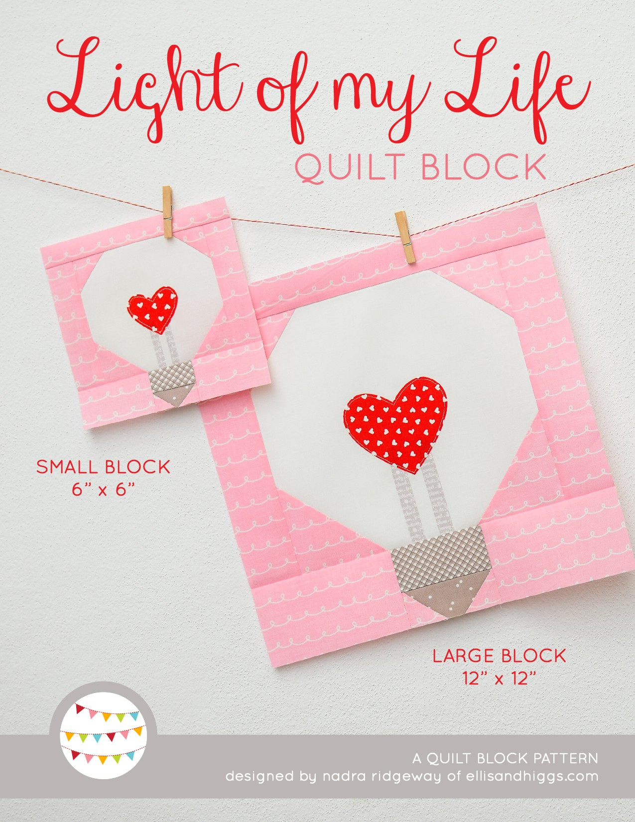 Heart Light Bulb quilt block in two sizes hanging on a wall