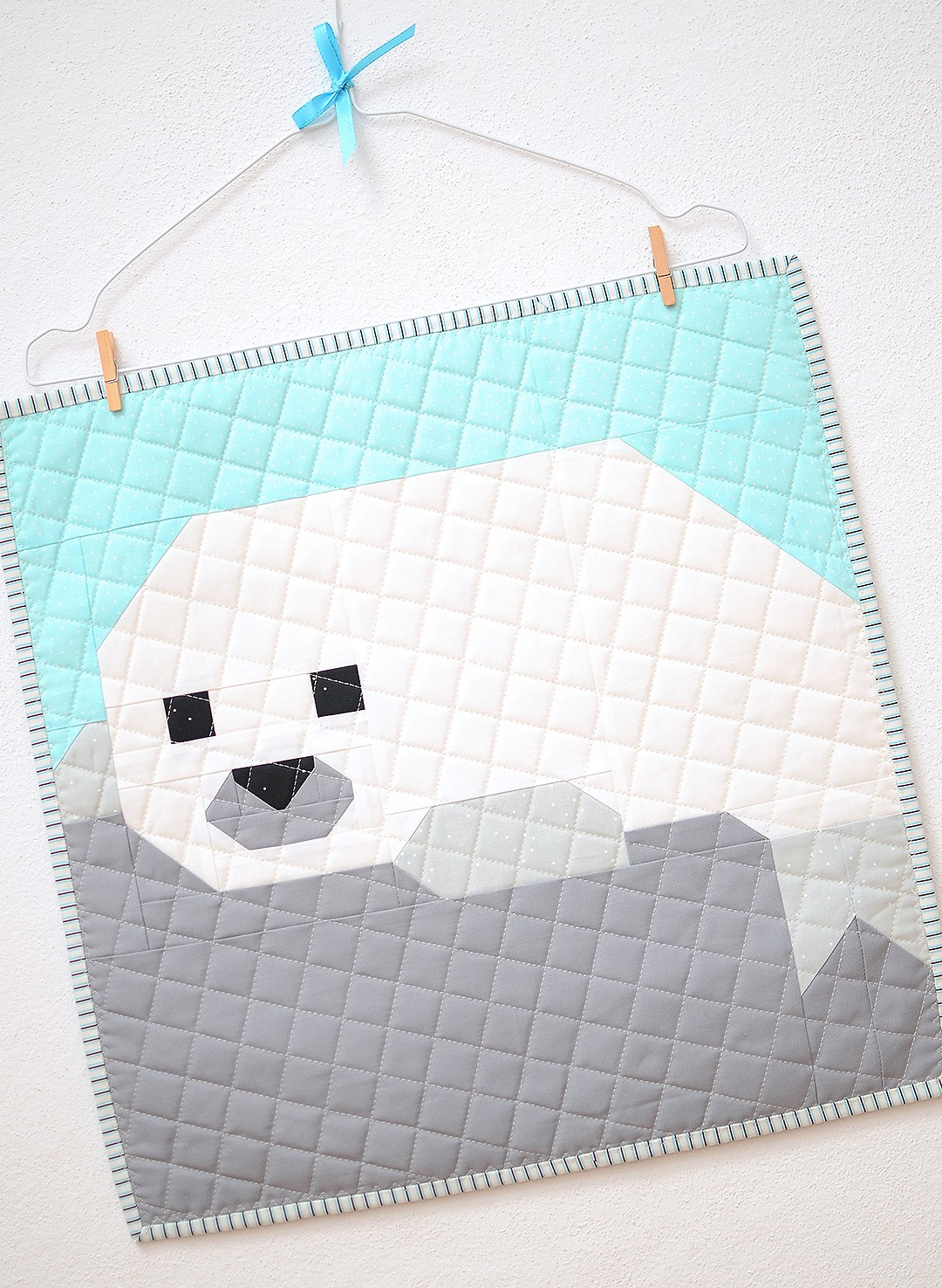 Seal Pup mini quilt on a wallhanger