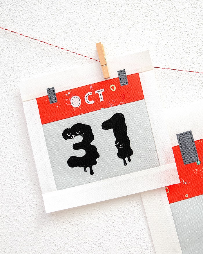6 Inch Calendar quilt block hanging on a wall