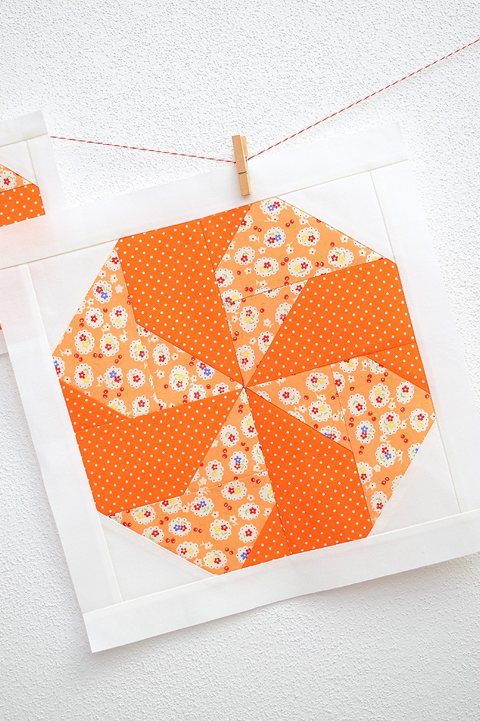 12 Inch Candy quilt block hanging on a wall