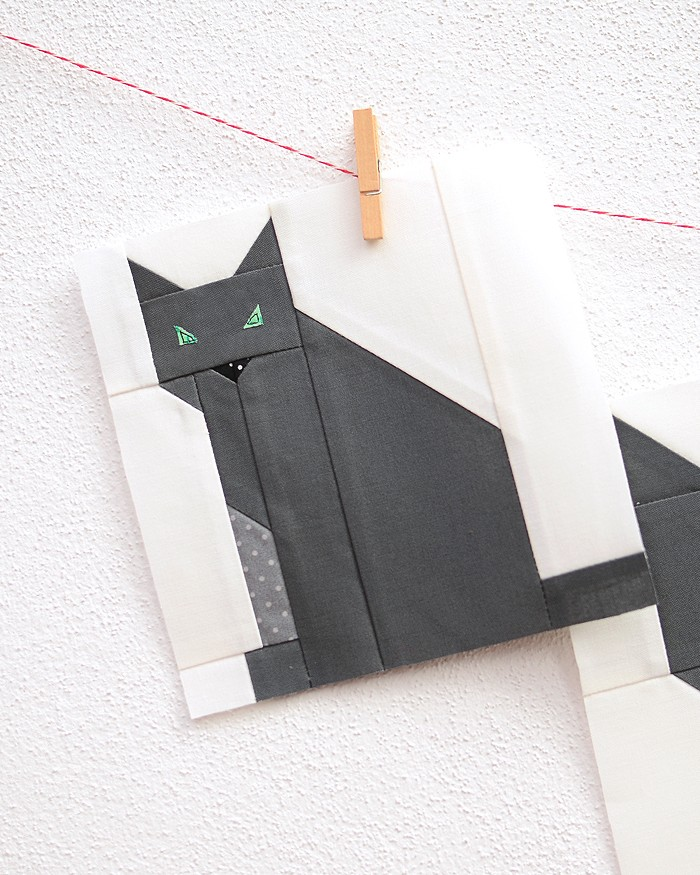 6 Inch Cat quilt block hanging on a wall