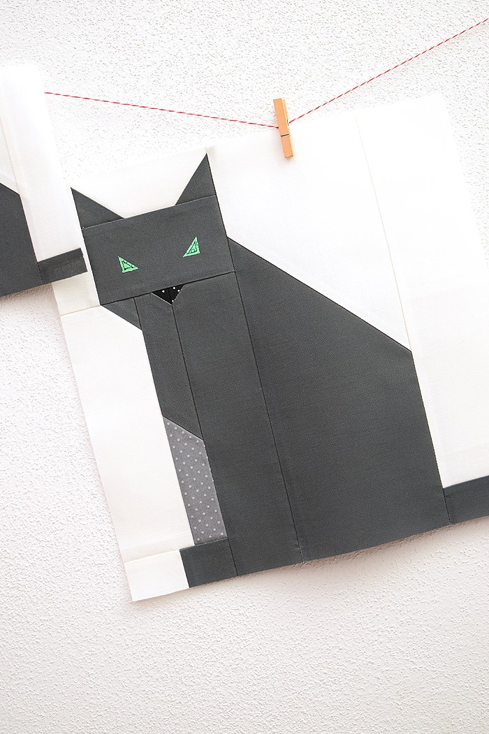 12 Inch Cat quilt block hanging on a wall