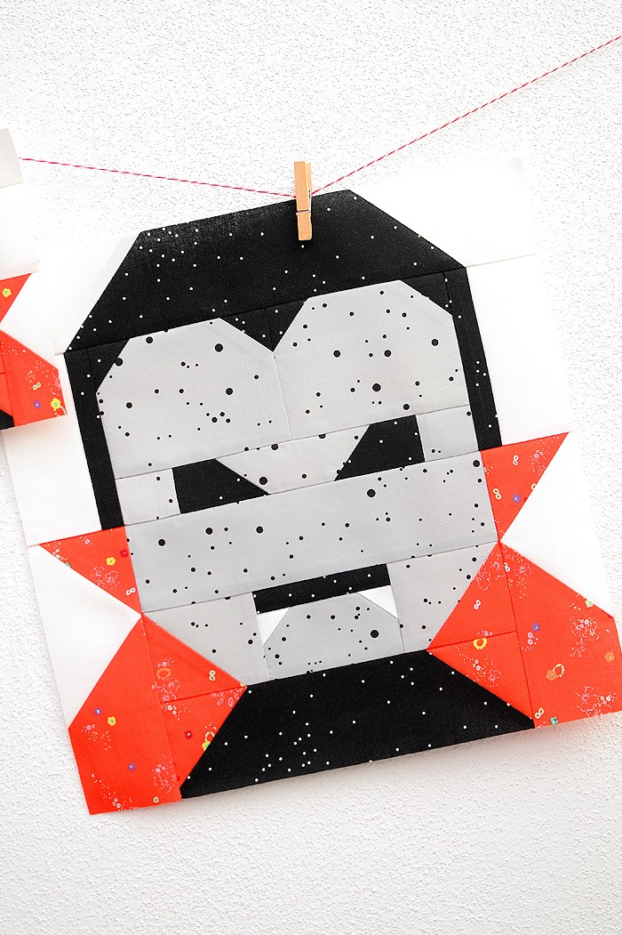 12 Inch Dracula quilt block hanging on a wall