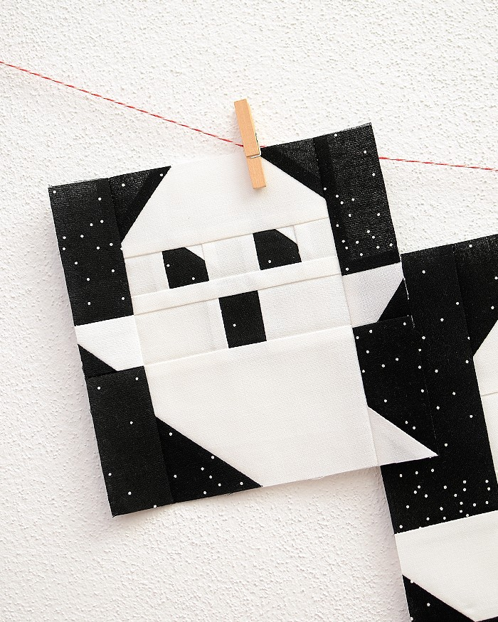 6 Inch Ghost quilt block hanging on a wall
