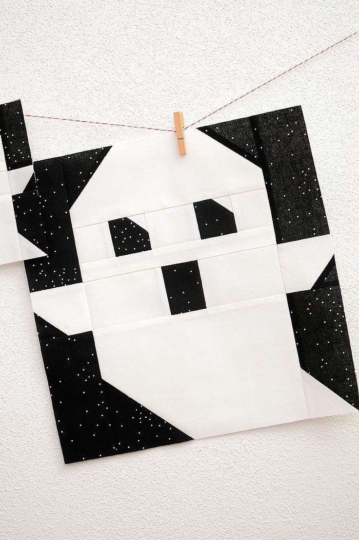 12 Inch Ghost quilt block hanging on a wall