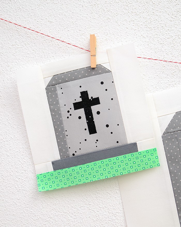 6 Inch Gravestone quilt block hanging on a wall