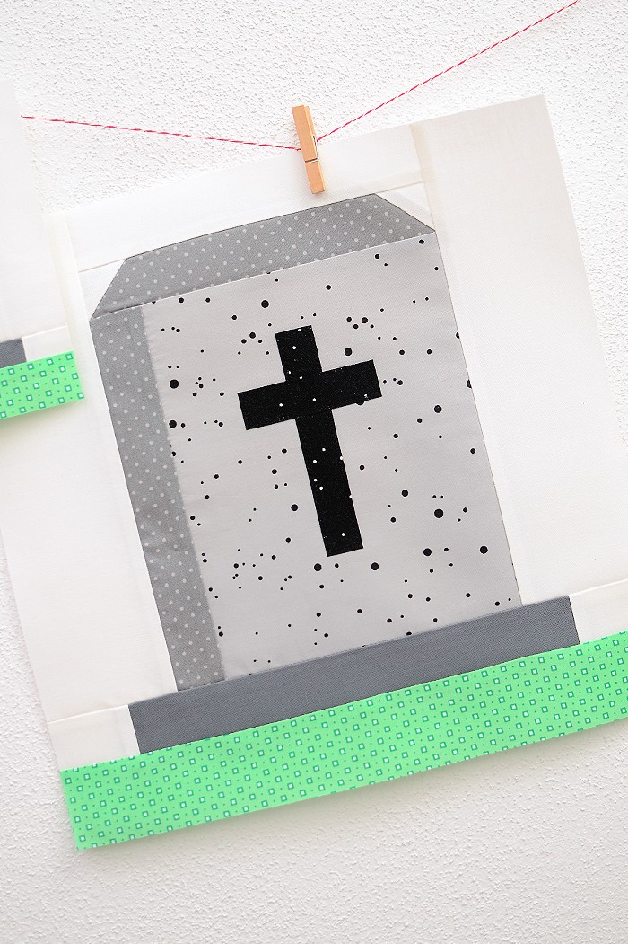 12 Inch Gravestone quilt block hanging on a wall