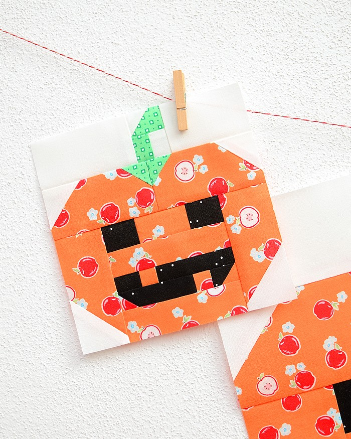 6 Inch Pumpkin quilt block hanging on a wall