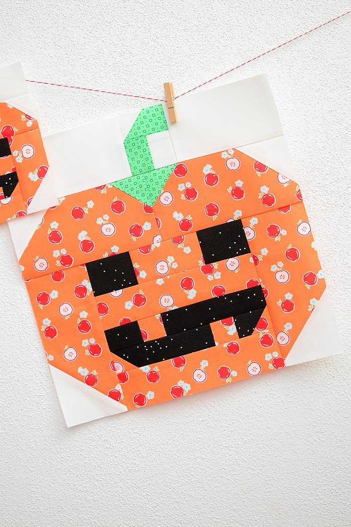 12 Inch Pumpkin quilt block hanging on a wall