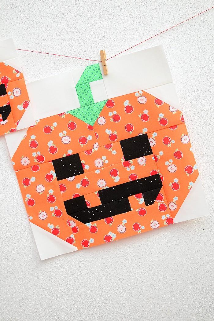 12 Inch Pumpkin quilt block hanging on a wall