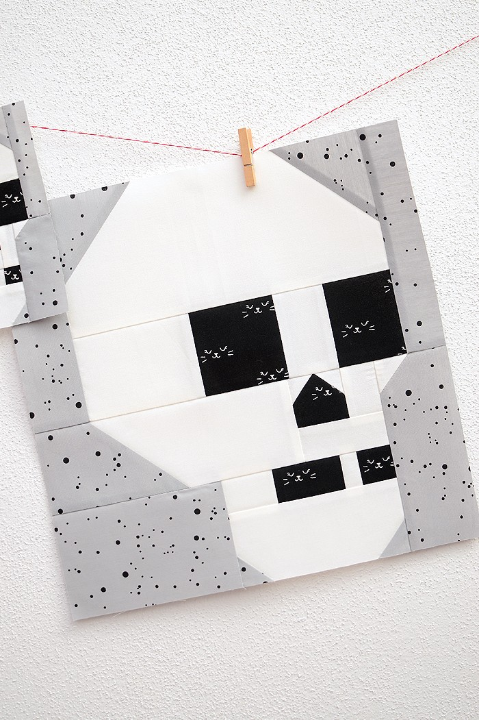12 Inch Skull quilt block hanging on a wall