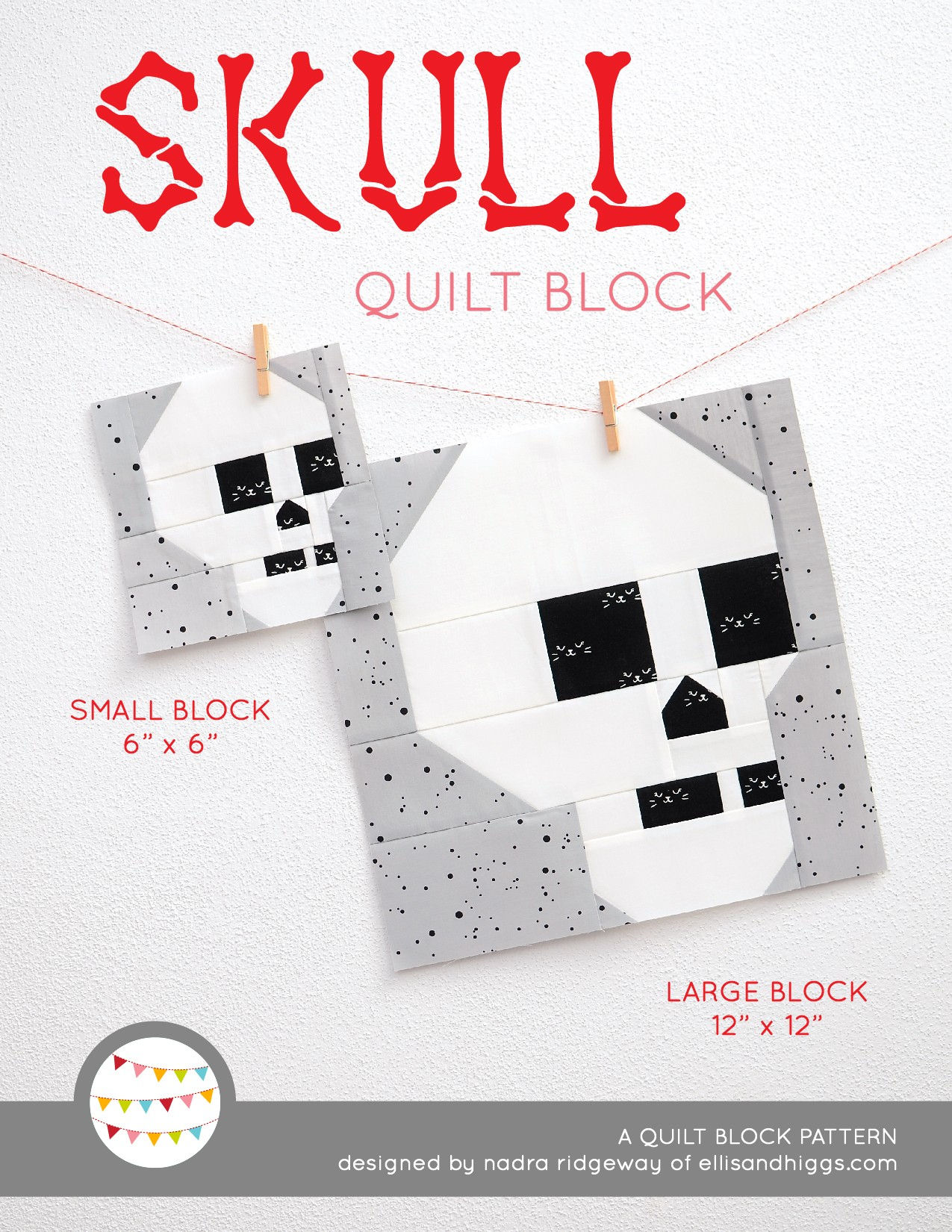 Skull quilt block in two sizes hanging on a wall