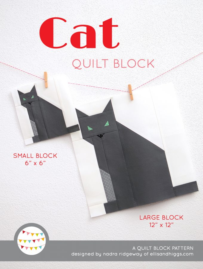 Cat quilt block in two sizes hanging on a wall