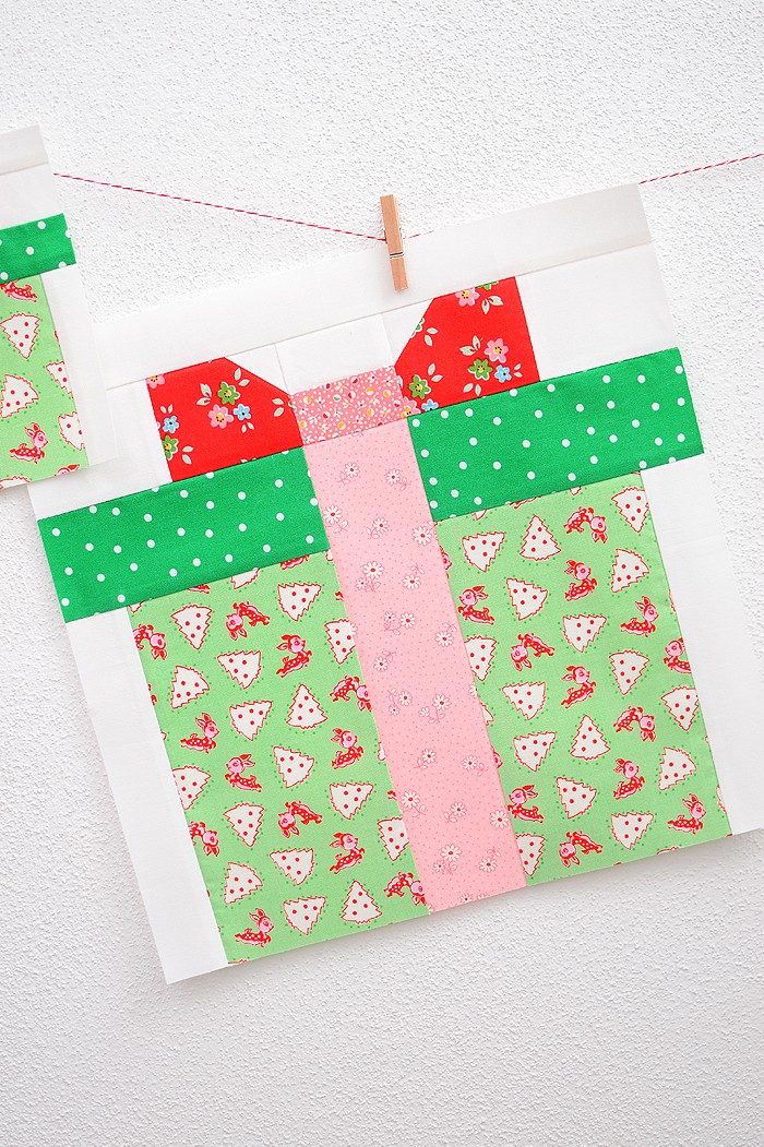 12 Inch Christmas Present quilt block hanging on a wall