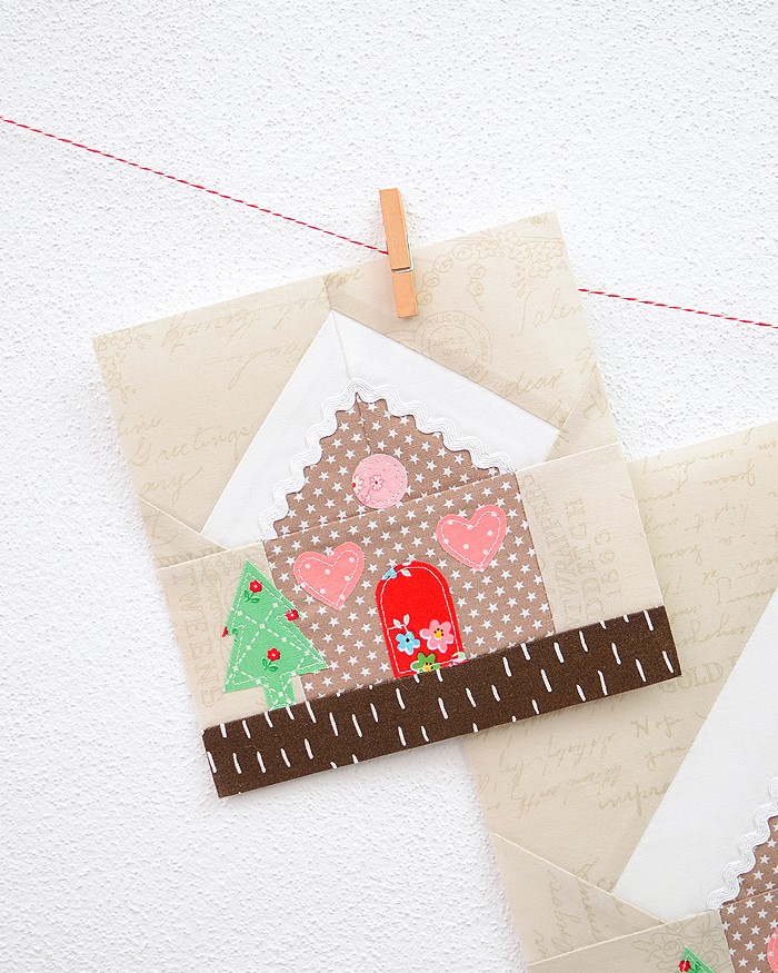 6 Inch Gingerbread House quilt block hanging on a wall