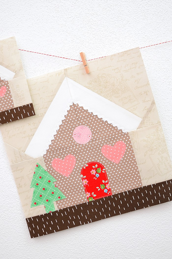 12 Inch Gingerbread House quilt block hanging on a wall