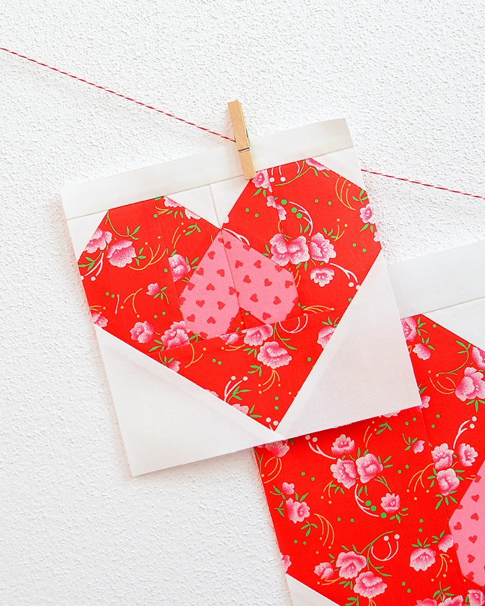 6 Inch Heart quilt block hanging on a wall