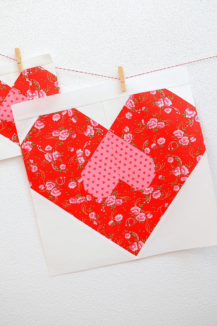 12 Inch Heart quilt block hanging on a wall
