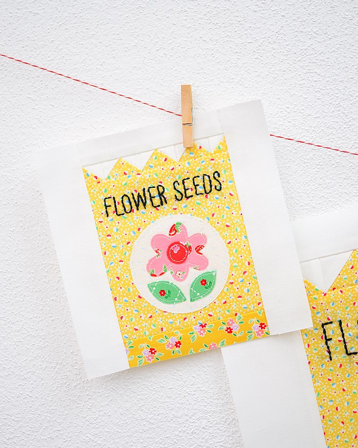 6 Inch Flower Seeds quilt block hanging on a wall