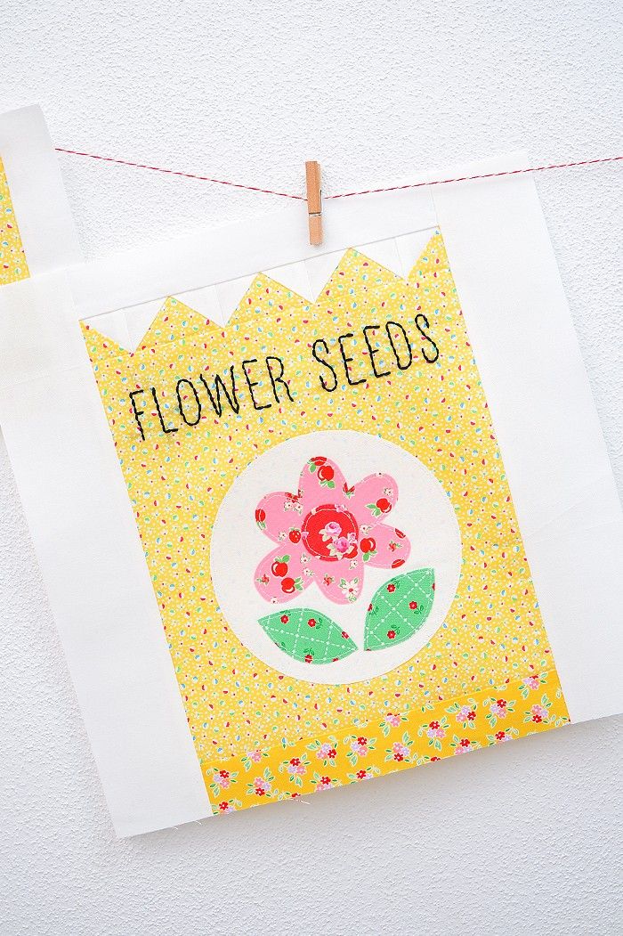 12 Inch Flower Seeds quilt block hanging on a wall