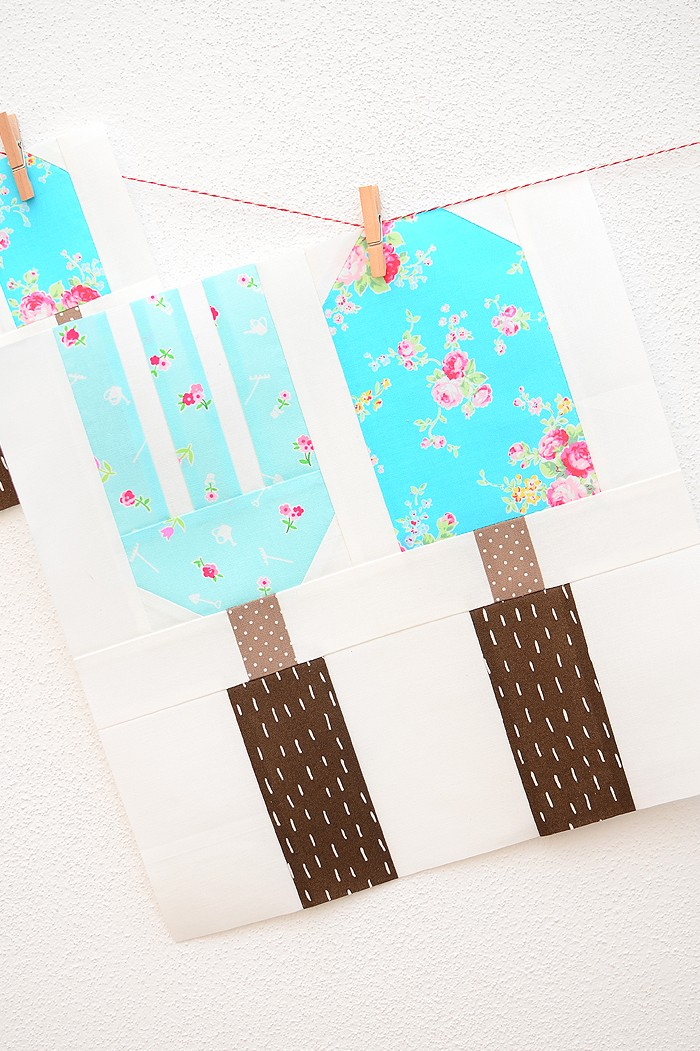 12 Inch Fork & Trowel quilt block hanging on a wall