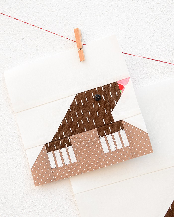 6 Inch Mole quilt block hanging on a wall