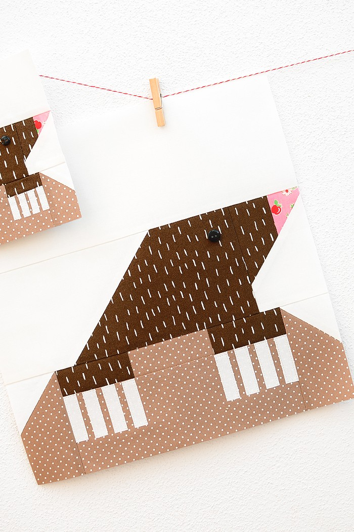 12 Inch Mole quilt block hanging on a wall
