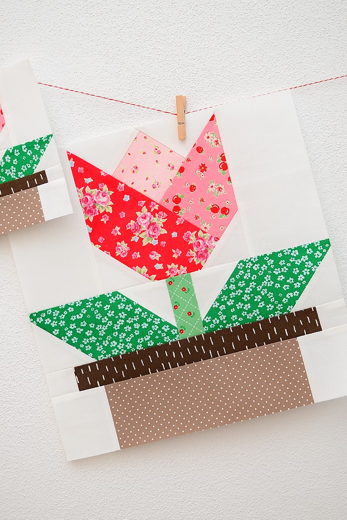 12 Inch Tulip quilt block hanging on a wall