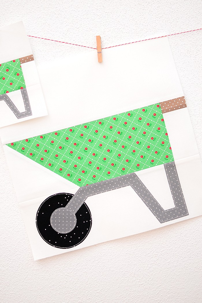 12 Inch Wheelbarrow quilt block hanging on a wall