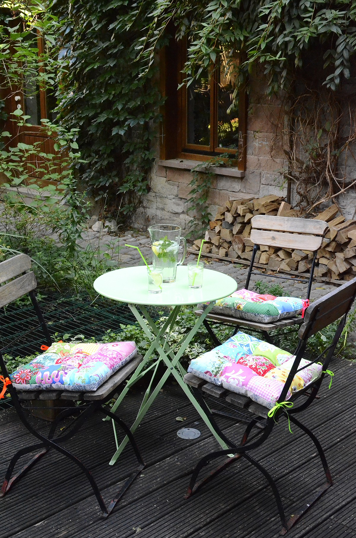 Beautiful Patio - patchwork pillows on garden chairs