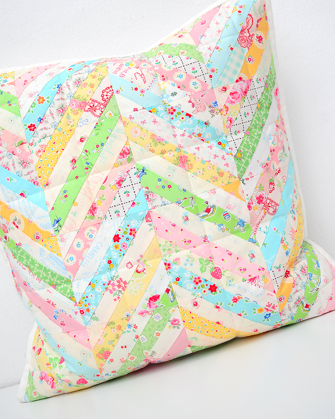 Foundation paper pieced Herringbone quilted pillow