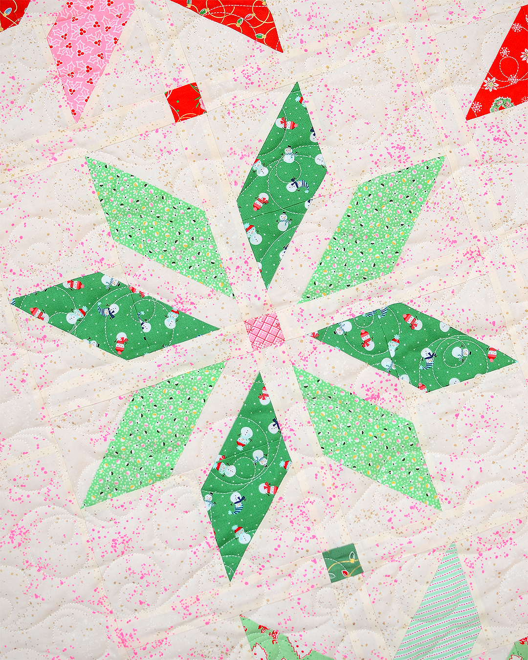 Green star quilt block in a Christmas quilt