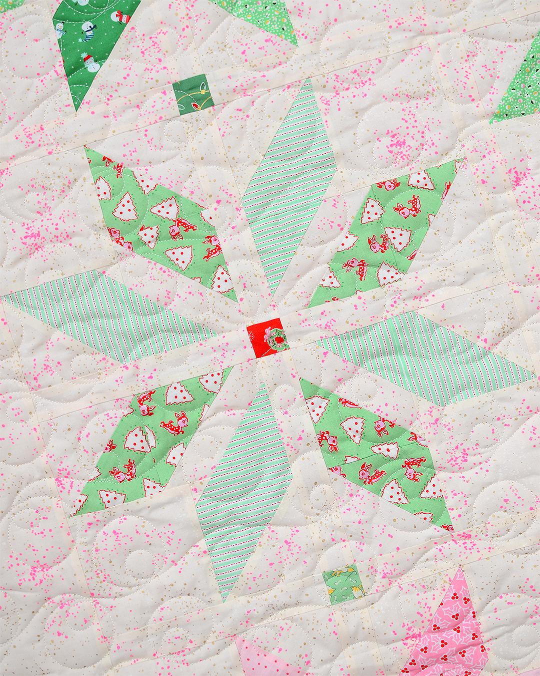 Light green star quilt block in a Christmas quilt