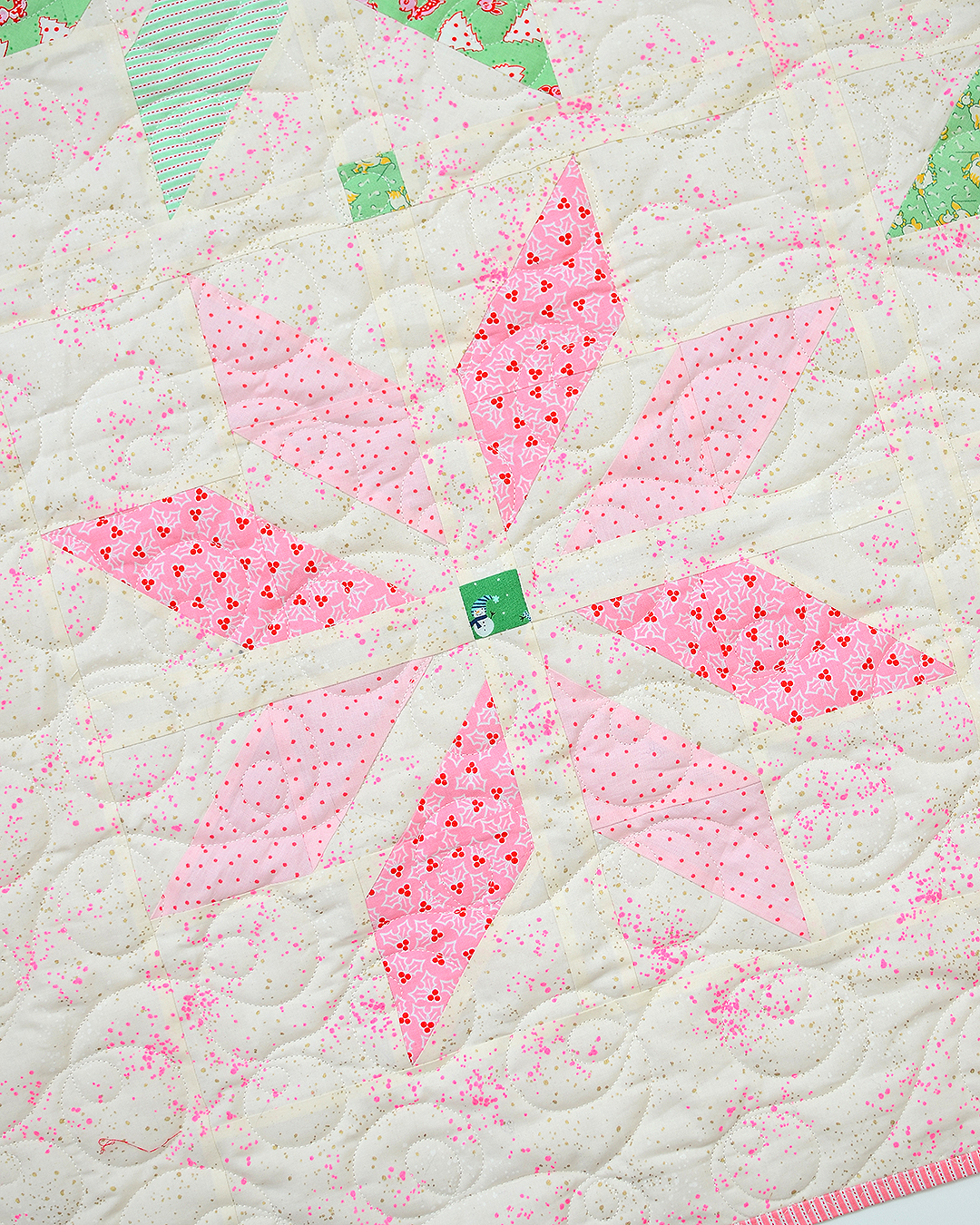 Pink star quilt block in a Christmas quilt